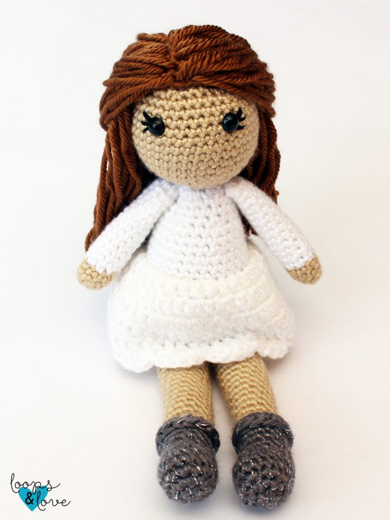 Photo of the crocheted doll sitting