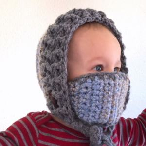 Photo of a young kid wearing the crocheted winter hood and mask